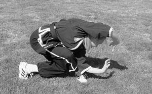 Oom Yung Doe instructor demonstrates flexibility